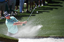 Charley Hoffman hits his ball from a sand bunker along the 2nd green during the third round of the Masters Tournament at Augusta National Golf Club in Augusta, Ga., on Saturday, April 8, 2017. (Photo by Jeff Siner/Charlotte Observer/TNS) *** Please Use Credit from Credit Field ***