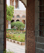The lush, green garden in a courtyard of a residence in the Christian quarter in Damascus, Syria