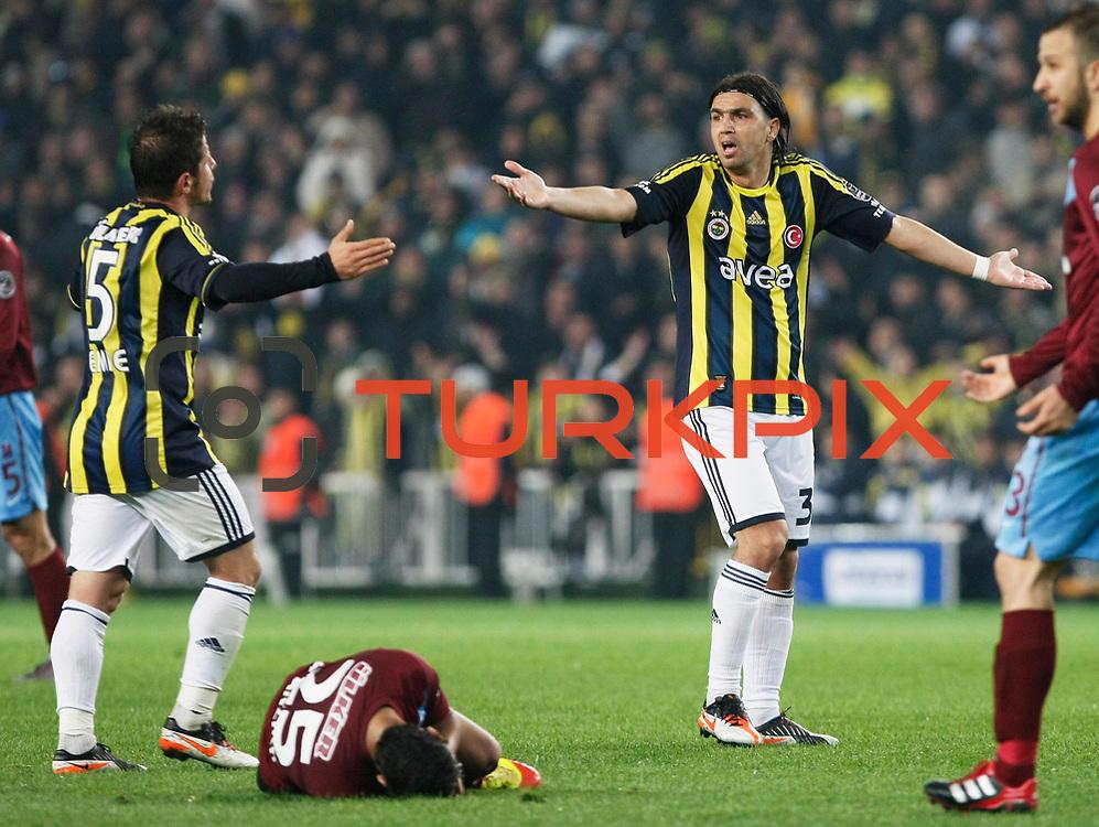 Fenerbahce's Mehmet Topuz (2ndR) during their Turkish superleague soccer derby match Fenerbahce between Trabzonspor at the Sukru Saracaoglu stadium in Istanbul Turkey on Sunday 18 December 2011. Photo by TURKPIX