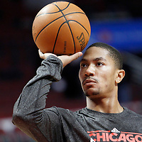 26 March 2012: Chicago Bulls point guard Derrick Rose (1) practices prior the Denver Nuggets 108-91 victory over the Chicago Bulls at the United Center, Chicago, Illinois, USA. NOTE TO USER: User expressly acknowledges and agrees that, by downloading and or using this photograph, User is consenting to the terms and conditions of the Getty Images License Agreement. Mandatory Credit: 2012 NBAE (Photo by Chris Elise/NBAE via Getty Images)