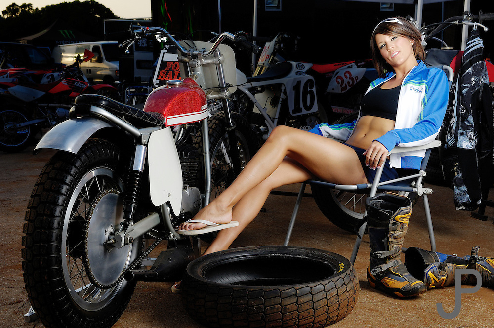 Crystal Peak (model released) relaxing in pits with Dick Mann replica OSSA flat track motorcycle.