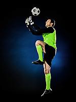 one caucasian goalkeeper soccer man isolated on black background