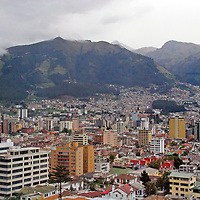 Americas, South America, Ecuador, Quito. At over 9,000 feet in elevation, the capitol of Ecuador, Quito, sits in a valley surrounded by the Andes mountains, providing countless scenic vistas. Quito was the first established  UNESCO World Heritage site.