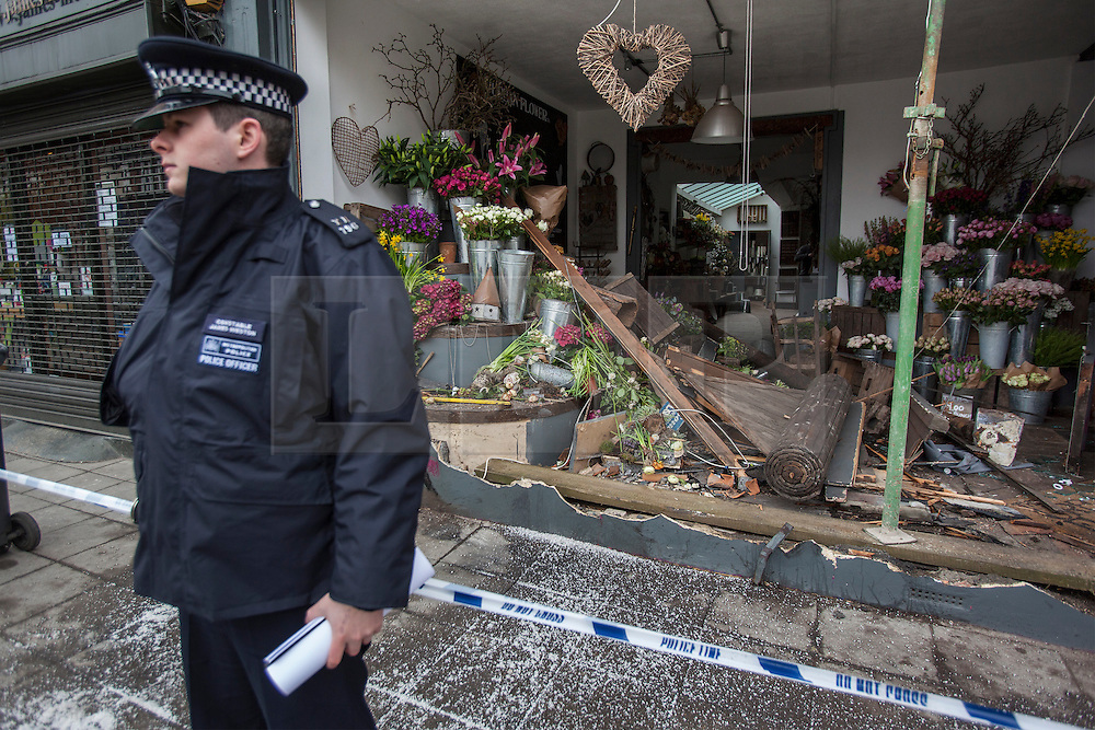 © licensed to London News Pictures. London, UK 10/04/2013. A florist shop wrecked by a armed response unit police car in a collision in Crouch End, north London on Tuesday night, 9 April 2013. Photo credit: Tolga Akmen/LNP
