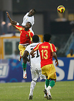 Photo: Steve Bond/Richard Lane Photography.<br />Ghana v Guinea. Africa Cup of Nations. 20/01/2008. John Mensah (upper) heads clear from Pascale Feindounou (lower left)