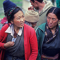 Sherpas women (Sherpanis) shop for supplies from lowland people who have carried big loads for several days to the weekly Saturday market in Namche Bazaar, the leading Sherpa town of Nepal's Himalaya.