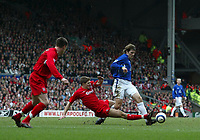 Photo: Andrew Unwin.<br />Liverpool v Everton. The Barclays Premiership. 25/03/2006.<br />Liverpool's Steven Gerrard (C) is sent off after this tackle on Everton's Kevin Kilbane (R).