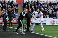 Swansea city manager Gary Monk looks on as he replaces Jose Canas with Michu ©. Barclays Premier league match, Swansea city v West Bromwich Albion at the Liberty Stadium in Swansea, South Wales on Saturday 15th March 2014. pic by Andrew Orchard,  Andrew Orchard sports photography.