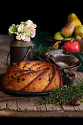 Bundt cake with homemade chocolate chips and autumn fruit on an old wooden table