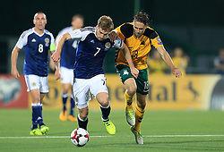 Scotland's Stuart Armstrong (left) and Lithuania's Arturas Zulpa battle for the ball during the 2018 FIFA World Cup Qualifying, Group F match at the LFF Stadium, Vilnius.