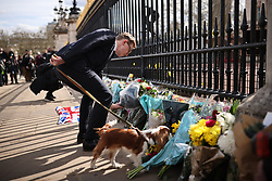 © Licensed to London News Pictures. 09/04/2021. London, UK. Flowers are left outside Buckingham Palace following the death of Prince Philip. The Duke of Edinburgh Prince Philip, Queen Elizabeth II's husband, has died aged 99 Buckingham Palace has announced. Photo credit: Rob Pinney/LNP