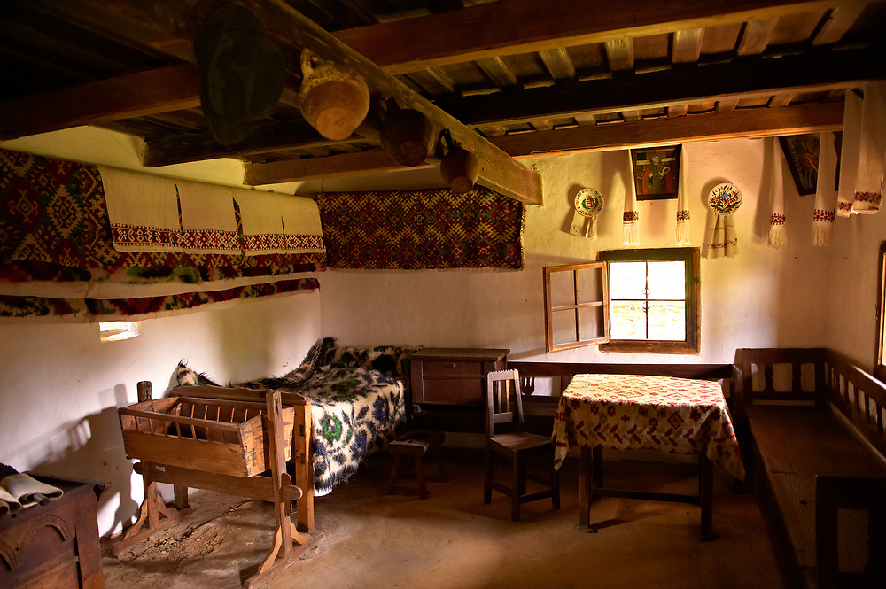 Rustic Interior of the 1798 wooden house from the valley of Izei, Wooden church on Dobaies. The Village museum near Sighlet, Maramures, Northern Transylvania .<br /> <br /> Visit our ROMANIA HISTORIC PLACXES PHOTO COLLECTIONS for more photos to download or buy as wall art prints https://funkystock.photoshelter.com/gallery-collection/Pictures-Images-of-Romania-Photos-of-Romanian-Historic-Landmark-Sites/C00001TITiQwAdS8