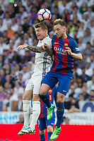 Toni Kroos of Real Madrid and Ivan Rakitic of FC Barcelona battles for an aerial ball during the match of La Liga between Real Madrid and Futbol Club Barcelona at Santiago Bernabeu Stadium  in Madrid, Spain. April 23, 2017. (ALTERPHOTOS)