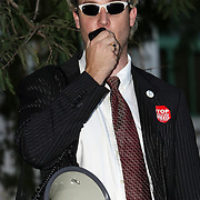 Reverend Faux speaks during an Occupy Orlando public demonstration in support of Occupy Wall Street gatherings across the country, at the Orange County History Center on Wednesday, October 5, 2011 in Orlando, Florida. (AP Photo/Alex Menendez)