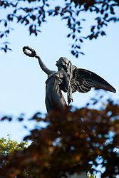The statue of Winged Victory holding a Laurel wreath that tops the York & Lancaster Regiments War Memorial in  Weston Park Sheffield<br />