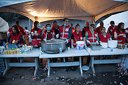 The Red Crescent prepare to serve rescue teams and families and friends of an estimated 120 minors still trapped underground at Soma mine, western Turkey. More than 238 have been killed in the worst mining incident in Turkey for decades, caused by an explosion after an electrical fault.
