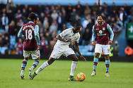 Eder of Swansea city breaks away from Kieran Richardson of Aston Villa (l). Barclays Premier league match, Aston Villa v Swansea city at Villa Park in Birmingham, the Midlands on Saturday 24th October 2015.<br /> pic by  Andrew Orchard, Andrew Orchard sports photography.