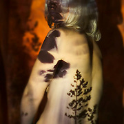 Adult nude woman in studio with waterfall projection