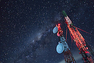 A communications tower with the Milky way galaxy inside the Bromo-Tengger-Semeru National Park in eastern Java. The park has three volcanoes and a large sandy caldera. Mt. Bromo is the most active of the three and consistently puffs steam and ash.