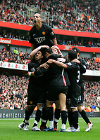 Photo: Tom Dulat/Sportsbeat Images.<br /> <br /> Arsenal v Manchester United. The FA Barclays Premiership. 03/11/2007.<br /> <br /> Manchester United's players celebrating Wayne Rooney's opener. Manchester leads 1-0
