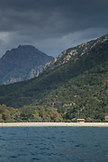 View of sea and coastline with beach and mountains, Golf of Porto, Corsica, France