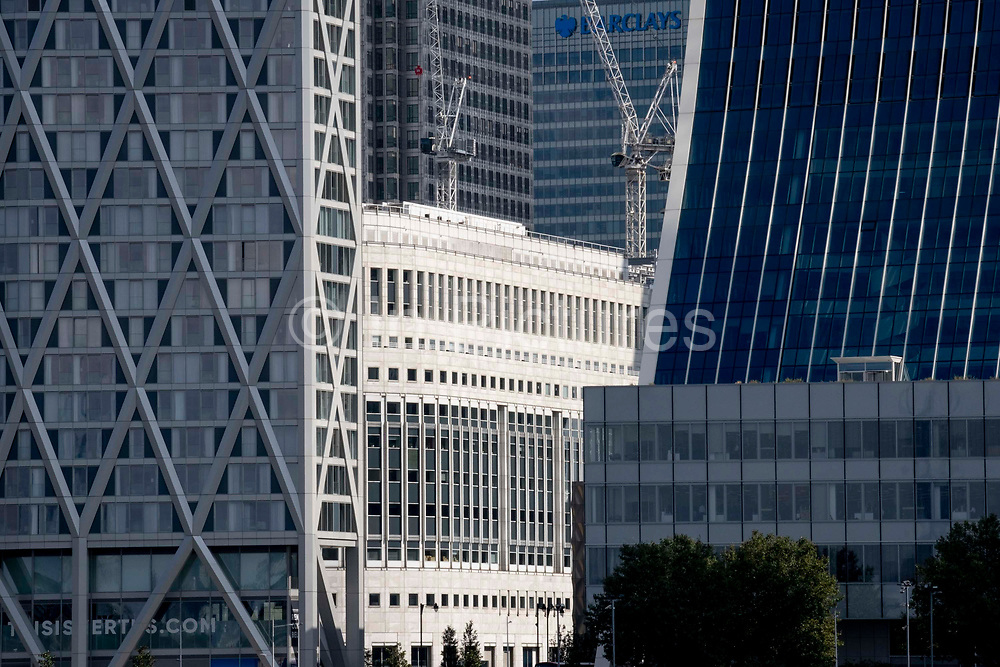 Corporate high-rise offices including the Barclays building at Canary Wharf in London Docklands, on 16th September 2021, in London, England. Canary Wharf was once a thriving Victorian cargo dock but after Thames shipping declined from the 1960s, its derelict areas were redeveloped in the 19080 by Margaret Thatchers Docklands Development Corporation created one of the UK's main financial centres, now home to the European Headquarters of numerous major banks including Barclays, Credit Suisse and HSBC.