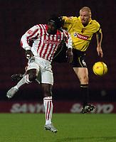 Fotball<br /> England 2004/2005<br /> Foto: SBI/Digitalsport<br /> NORWAY ONLY<br /> <br /> Date: 04/12/2004<br /> <br /> Watford v Stoke City <br /> Coca Cola Championship<br /> <br /> Watford's Sean Dyche challenges Stoke's Ade Akinbiyi