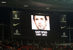 LONDON, ENGLAND - Tuesday, November 29, 2011:The scoreboard displays an image of Gary Speed during a minute's silence prior to the football match of English Football League Cup, Quarter-Final, between FC Arsenal and Manchester City FC at Emirates Stadium, London, United Kingdom on 2011/11/29. EXPA Pictures © 2011, PhotoCredit: EXPA/ Sportida/ Chris Brunskill..***** ATTENTION - OUT OF ENG, GBR, UK *****
