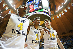 Jan 9, 2018; Morgantown, WV, USA; West Virginia Mountaineers guard Daxter Miles Jr. (4) and West Virginia Mountaineers guard James Bolden (3) and West Virginia Mountaineers guard Chase Harler (14) celebrate after beating the Baylor Bears at WVU Coliseum. Mandatory Credit: Ben Queen-USA TODAY Sports