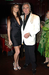 PETER STRINGFELLOW and BELLA WRIGHT at a fund raising dinner hosted by Marco Pierre White and Frankie Dettori's in aid of Conservative Party's General Election Campaign Fund held at Frankie's No.3 Yeoman's Row,æLondon SW3 on 17th January 2005.<br />