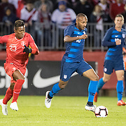 EAST HARTFORD, CONNECTICUT- October 16th:   Julian Green #16 of the United States defended by midfielder Pedro Aquino #23 of Peru during the United States Vs Peru International Friendly soccer match at Pratt & Whitney Stadium, Rentschler Field on October 16th 2018 in East Hartford, Connecticut. (Photo by Tim Clayton/Corbis via Getty Images)