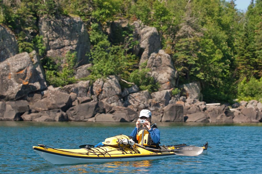 A kayaker takes photos at Isle Royale National Park.