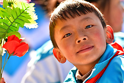 March 28, 2019 - Lhasa, Tibet - A boy is seen at a convention celebrating the 60th anniversary of the campaign of democratic reform in Tibet at the Potala Palace square in Lhasa, capital of southwest China's Tibet Autonomous Region. (Credit Image: © Xinhua via ZUMA Wire)