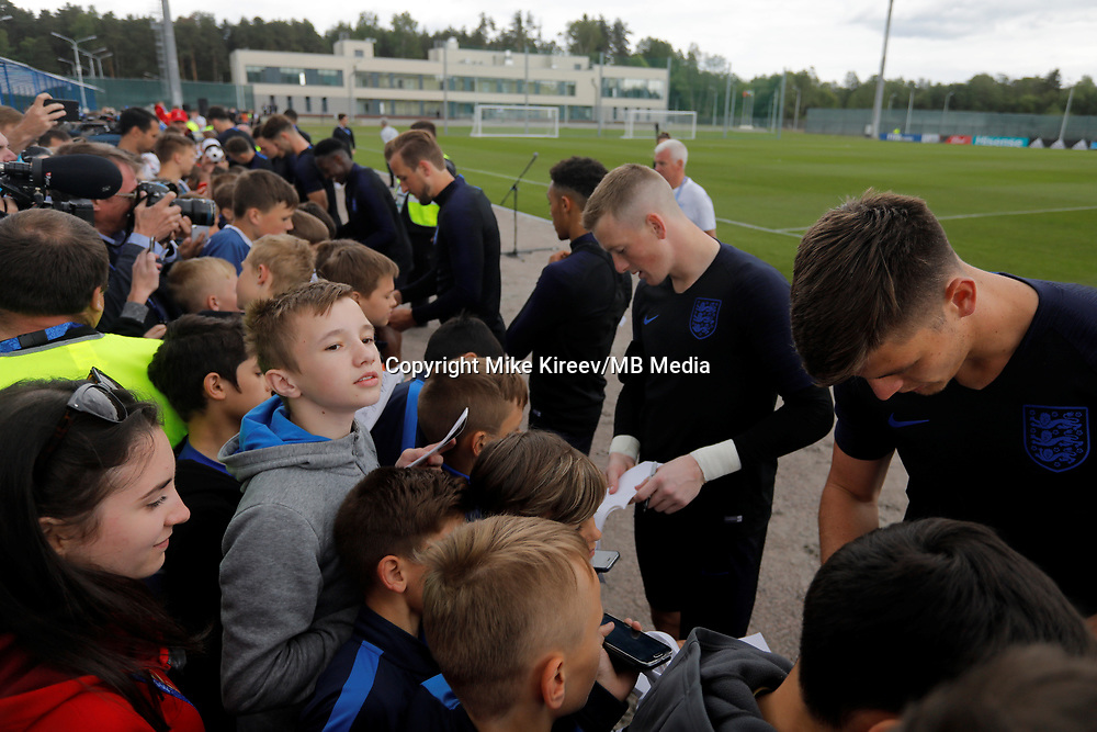 SAINT PETERSBURG, RUSSIA - JUNE 13: England national team players sign autographs after an England national team training session ahead of the FIFA World Cup 2018 in Russia at Stadium Spartak Zelenogorsk on June 13, 2018 in Saint Petersburg, Russia.