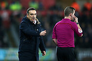 Swansea city manager Carlos Carvalhal has a chat with assistant referee /linesman Marc Perry during the Premier league match, Swansea city v Tottenham Hotspur at the Liberty Stadium in Swansea, South Wales on Tuesday 2nd January 2018. <br /> pic by  Andrew Orchard, Andrew Orchard sports photography.