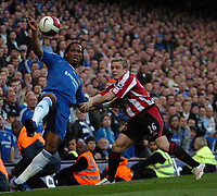 Photo: Tony Oudot.<br />Chelsea v Sheffield United. The Barclays Premiership. 17/03/2007.<br />Didier Drogba of Chelsea with Derek Geary of Sheffield United
