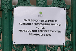 © Licensed to London News Pictures. 09/02/2020. London, UK.Royal Park signs indicate Hyde Park is closed to the public. High winds of up to 60mph hit London as Storm Ciara hits central London. Photo credit: Ray Tang/LNP