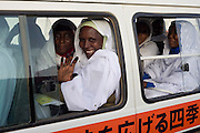 Crammed in a small minibus with Chinese writing on the side, delegates attending the first-ever international Conference on Womens' Challenge in Darfur, leave the compound belonging to the Govenor of North Darfur in Al Fasher (also spelled, Al-Fashir) where the women from remote parts of Sudan gathered to discuss peace and political issues.