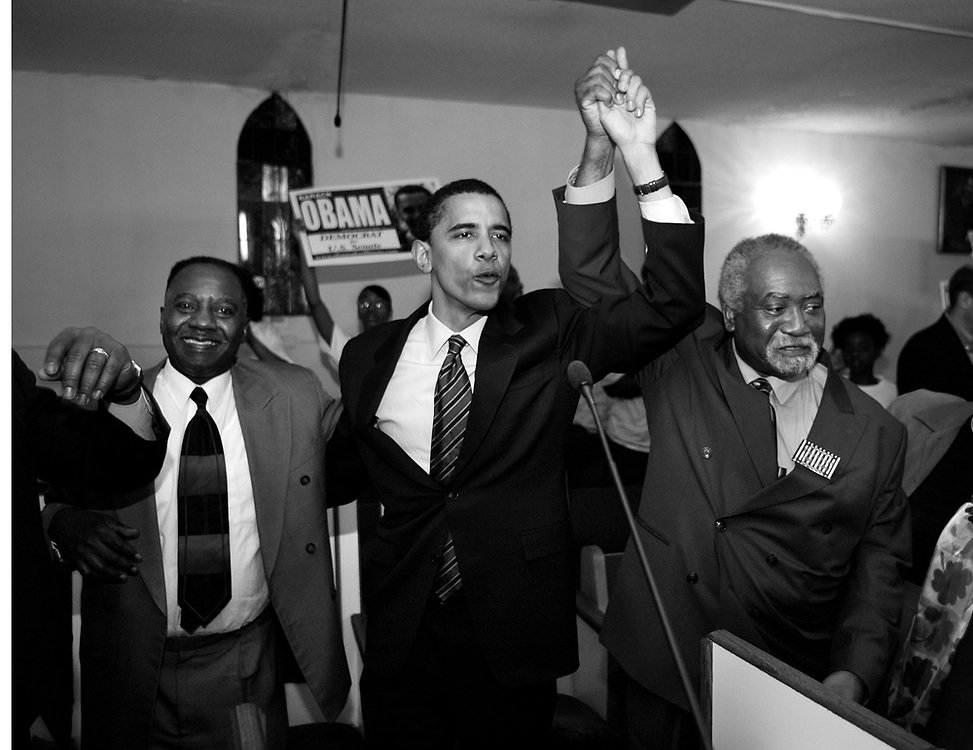 Illinois State Senator and U.S. Senate candidate Barack Obama joins hands with U.S. Rep Danny Davis (D-Illinois), right, and Illinois State Senator Ricky Hendon at a rally at Community Fellowship Baptist Church as campaigns on the west side of Chicago Saturday March 6, 2004.