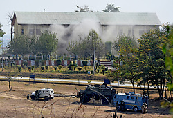 October 3, 2017 - Srinagar, Jammu and Kashmir, India - Indian Army men take cover behind the armored vehicles at the encounter site..Three suspected militants attacked the Army base in Humhama area of Srinagar on Tuesday midnight. The camp is a high security zone and is near to the international Airport. One Indian police constable and two militants have been killed so far, operation is on. (Credit Image: © Muzamil Mattoo/Pacific Press via ZUMA Wire)