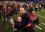 Edgewood band director Aaron Wells hugs Stephanie Warthan after the Mustangs were runner up in the ISSMA Marching Band state finals at Lucas Oil Stadium in Indianapolis. (Photo by Jeremy Hogan) <br /> PR_edgewood_a1_1030