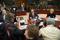 George Papaconstantinou, Greece's finance minister, is the center of attention as he arrives for the meeting of European Union finance ministers, at the EU headquarters in Brussels, Belgium, on Tuesday, March 16, 2010. (Photo © Jock Fistick)