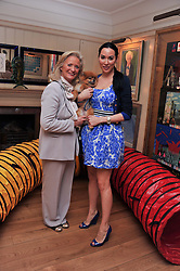 Left to right, CLARISSA BALDWIN Chief Executive Officer of Dogs Trust and ALEX MEYERS and her dog Ribbons at The Dog's Trust Awards announcement held at George, 87-88 Mount Street, London on 27th March 2012.
