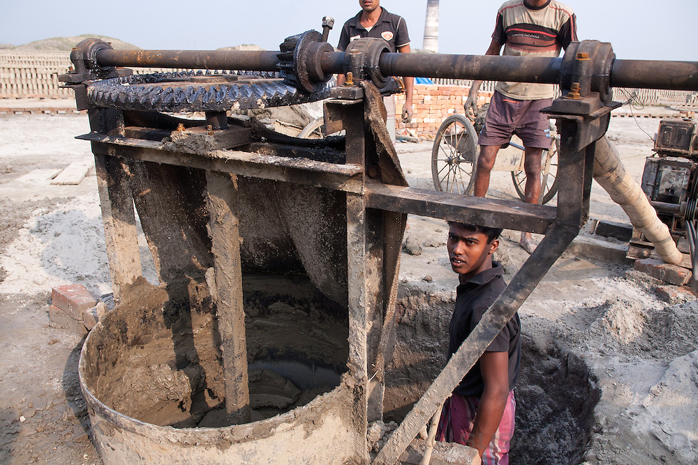 A machine to stir the mud into the right consistency for making bricks, Bangladesh.