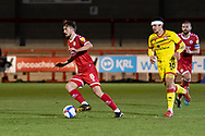 Crawley Town midfielder Jack Powell(#8) on the ball is chased by Walsall forward Josh Gordon (#10) during the EFL Sky Bet League 2 match between Crawley Town and Walsall at The People's Pension Stadium, Crawley, England on 16 March 2021.