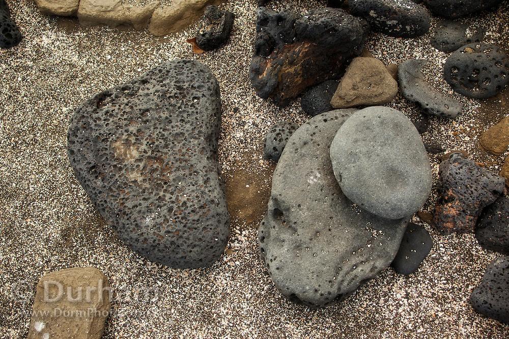 Interesting mixture of volcanic rocks along the shore of James Bay, Santiago Island, Galapagos Archipelago - Ecuador.