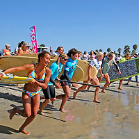 Team Roxy girls head out for an exciting relay of Stand Up Paddling, sponsored by Surftech, at the 2008 3rd Annual Roxy Jam in Cardiff.
