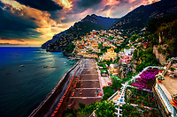 """""""Ominous evening clouds above Positano""""…<br /> <br /> After an exhilarating drive along the high cliffs on the Amalfi coast from Sorrento down to Positano, I found myself in sensory overload with its beauty and photogenic appeal.  After circling around the entire village and its cliffside three times on Positano's only street, which was a single lane winding down from the top and back up and over to where I began, I finally found the parking garage by the hotel, about 2/3rds up the facing village in this image.  The climb down the winding road and steep staircases made for quite a workout in the hot late May sun.  Reaching the beach and marina, I forgot about my exhaustion and could not capture enough of Positano's plush beauty; however, the large amount of tourists and bright sun did not allow for ideal conditions.  Walking the length of the beach, I found a very, very steep staircase leading straight up to a large veranda at the Albergo California.  Taking an exhaustive seat on a plush lounge chair with a perfect view to watch the sunset behind the Amalfi Cliffs, I was taken back by a pleasant Italian (Positano) waiter from the hotel offering a towel, ice water, and drinks for the evening.  I expressed that I was not staying at the hotel, but he didn't seem to mind and proceeded to educate me on the culture of this historic resort village.  The sunset was being coy and didn't appear to cooperate, but during opportune moments it mystified the ominous clouds, and contributed just enough light and color to satisfy a weary photographer."""