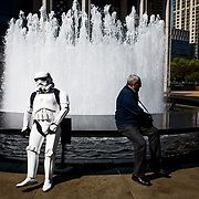 A fan dressed as a storm trooper from the movie Star Wars sits by a fountain at the Lincoln Center in Manhattan, New York on May 4, 2017. The New York Philharmonic celebrated Star Wars Day by giving fans who arrive in costume to the David Geffen Hall Box Office early access to tickets to the Star Wars Film Concert Series. John Taggart for The Wall Street Journal