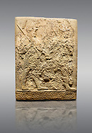 Picture & image of Hittite sculpted orthostats panels of Long Wall Limestone, Karkamıs, (Kargamıs), Carchemish (Karkemish), 900-700 B.C. Soldiers. Anatolian Civilisations Museum, Ankara, Turkey<br /> <br /> Figure of two helmeted warriors. They have their shield in their back and their spear in their hand. The prisoner in their front is depicted as small. The lower part of the orthostat is decorated with braiding motifs. <br /> <br /> On a gray background. .<br />  <br /> If you prefer to buy from our ALAMY STOCK LIBRARY page at https://www.alamy.com/portfolio/paul-williams-funkystock/hittite-art-antiquities.html  - Type  Karkamıs in LOWER SEARCH WITHIN GALLERY box. Refine search by adding background colour, place, museum etc.<br /> <br /> Visit our HITTITE PHOTO COLLECTIONS for more photos to download or buy as wall art prints https://funkystock.photoshelter.com/gallery-collection/The-Hittites-Art-Artefacts-Antiquities-Historic-Sites-Pictures-Images-of/C0000NUBSMhSc3Oo